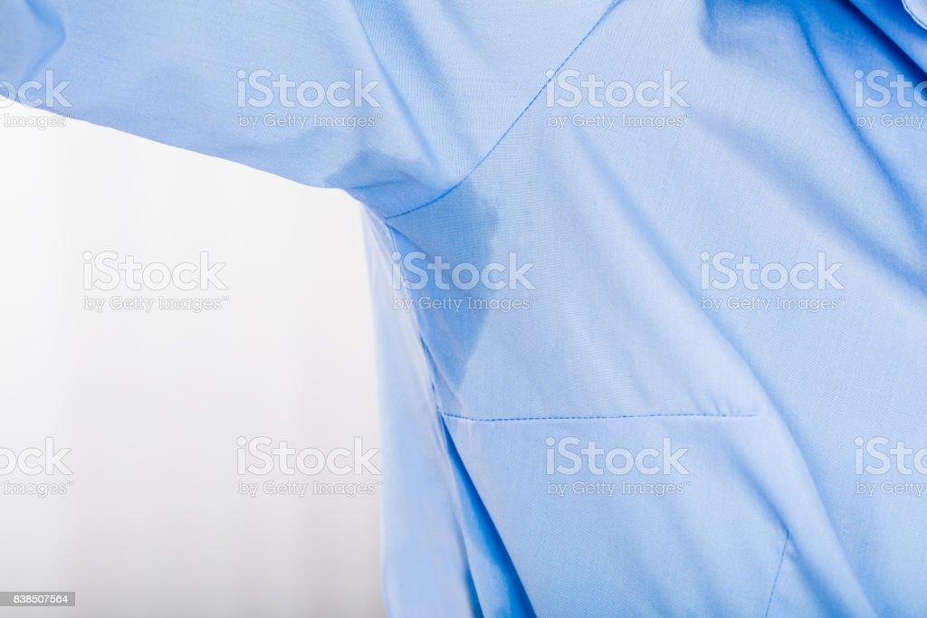 Woman Notices Her Sweat Under Armpit stock photo
