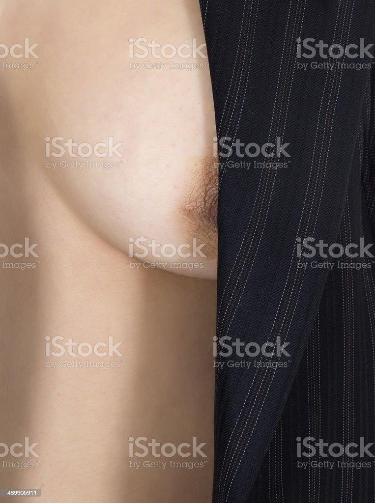 Woman nude in blazer stock photo