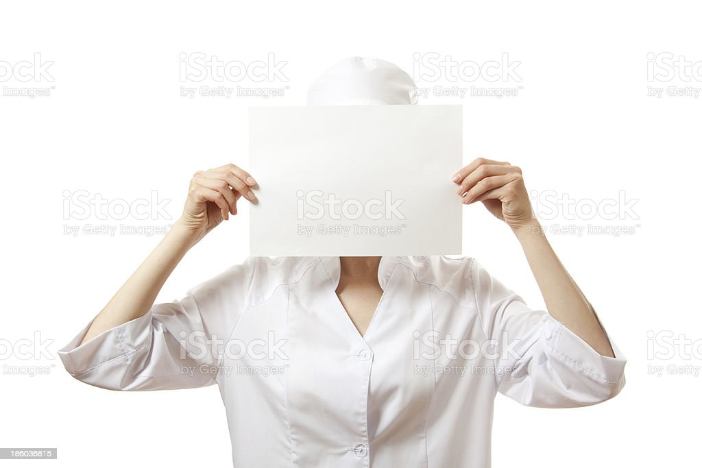 woman nurse showing blank sign board, isolated. royalty-free stock photo