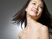 istock Woman of a smiling face looks up 155441499