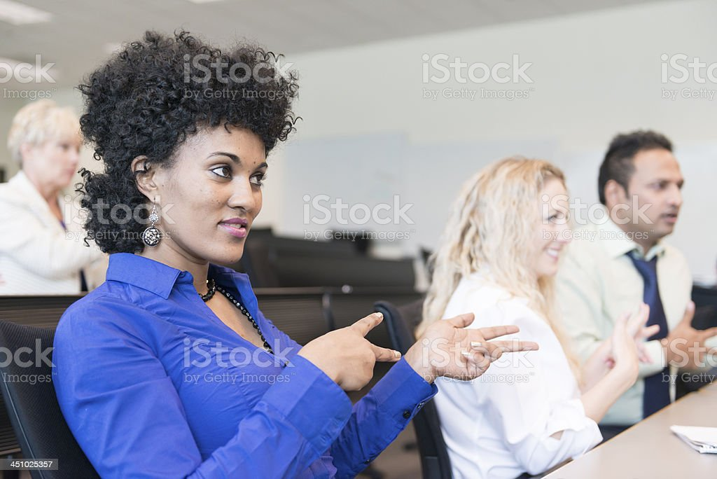 Woman of African descent in ASL Class stock photo