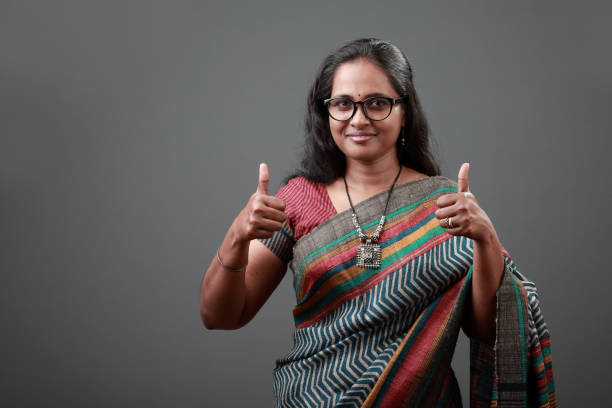 Woman of Indian origin shows thumbs up stock photo