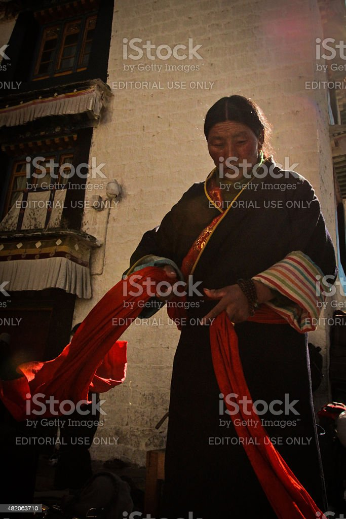 Woman of Jokhang Temple and Barkhor Square, Lhasa, Tibet stock photo