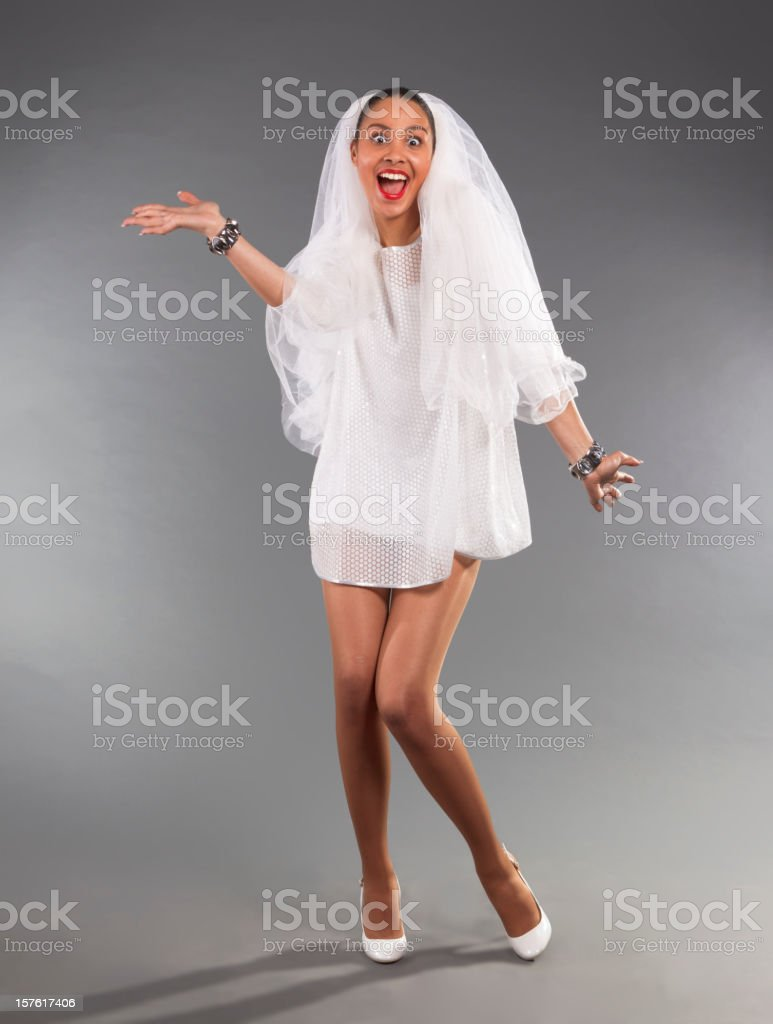 Woman of mixed race in a white wedding dress. royalty-free stock photo
