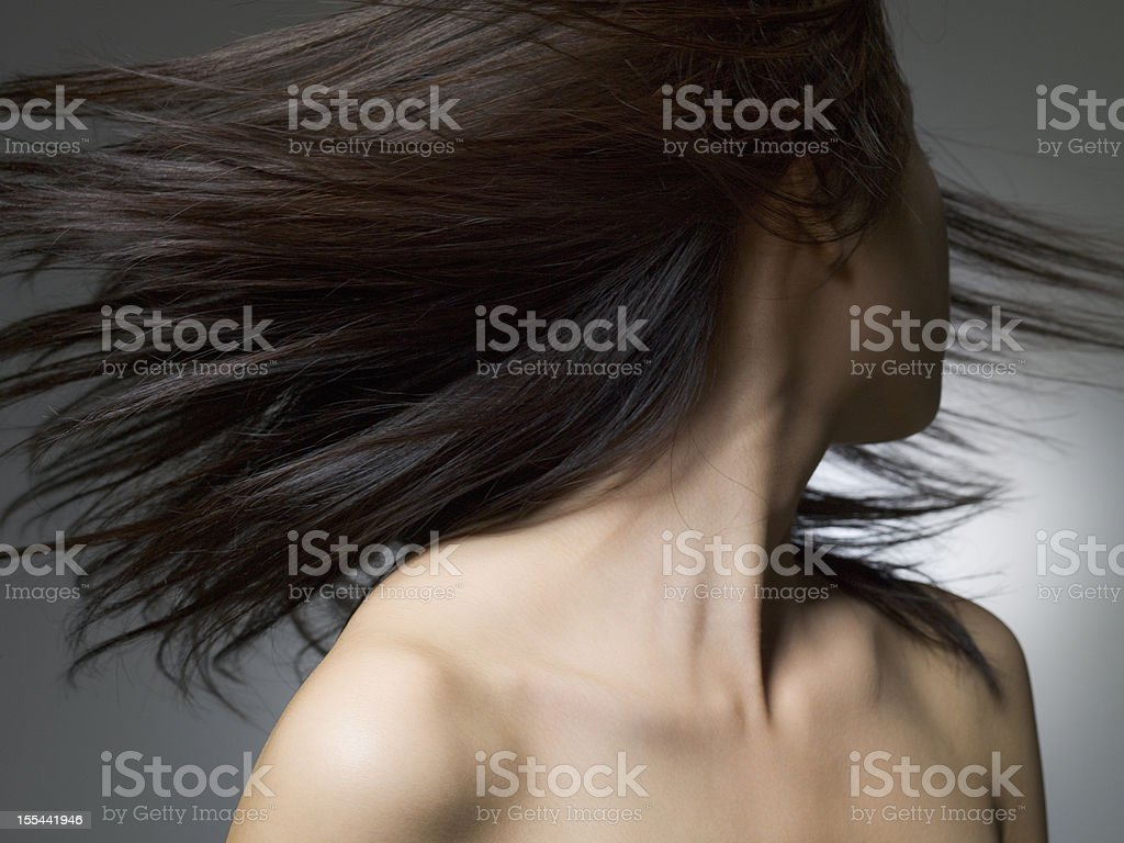 Woman of the black hair upon which it looks back stock photo