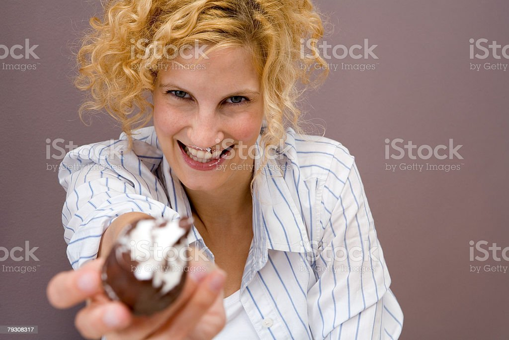 Woman offering a cake royalty-free 스톡 사진