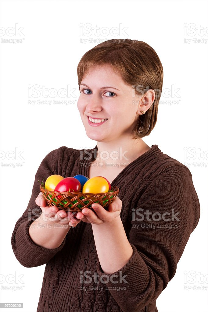 Woman offering easter eggs royalty-free stock photo