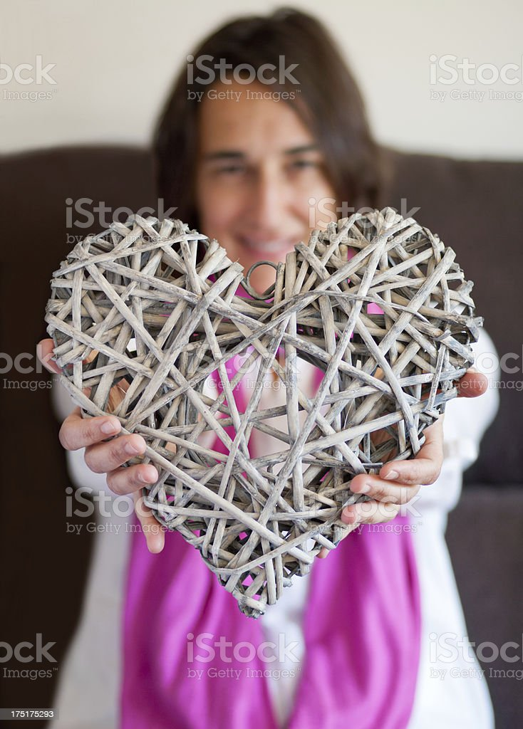 Woman offering her heart. royalty-free stock photo