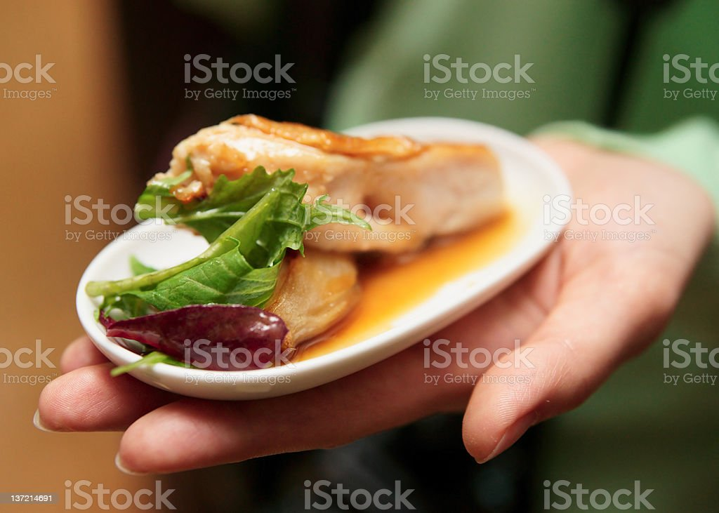 Woman offering snack stock photo