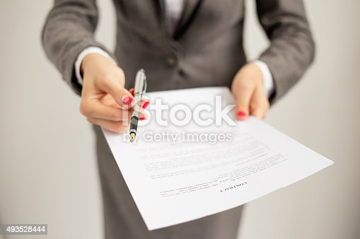 istock Woman offering to sign papers 493528444