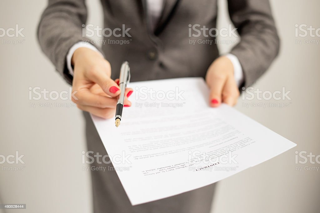 Woman offering to sign papers stock photo