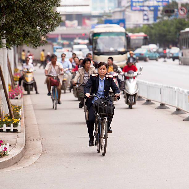 woman - officer on the bicycle - chinese military bildbanksfoton och bilder