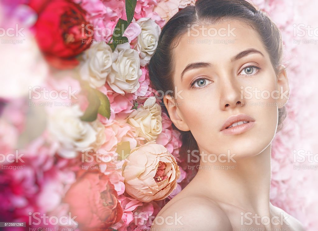 woman on a background of flowers stock photo