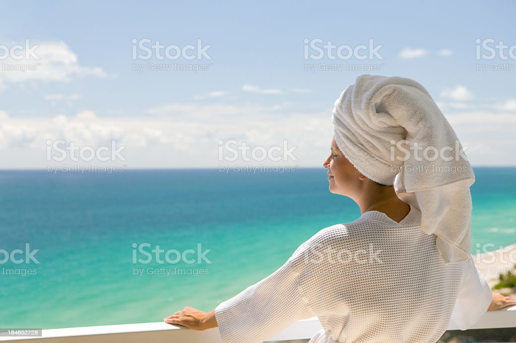 woman on a balcony of the high-rise in Miami royalty-free stock photo