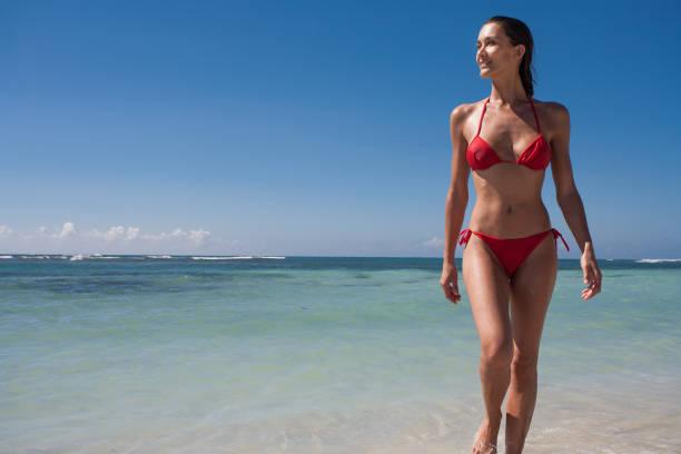 woman on a beautiful beach stock photo