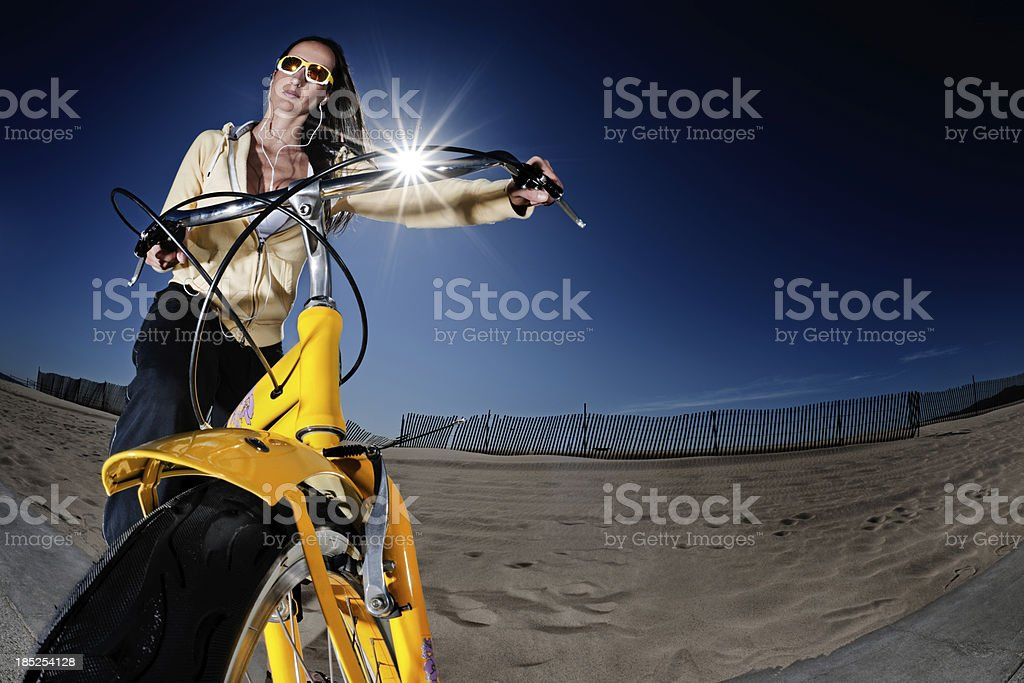 Woman on a bicycle royalty-free stock photo
