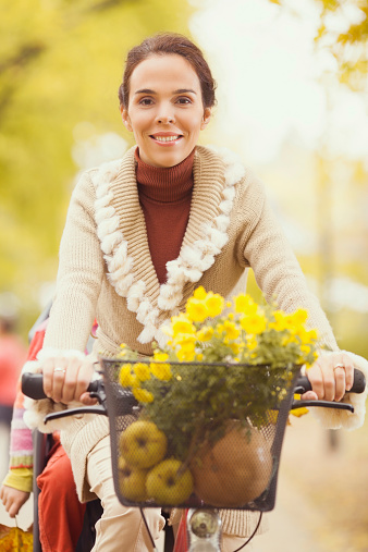 628409126 istock photo Woman on a Bicycle 534713411