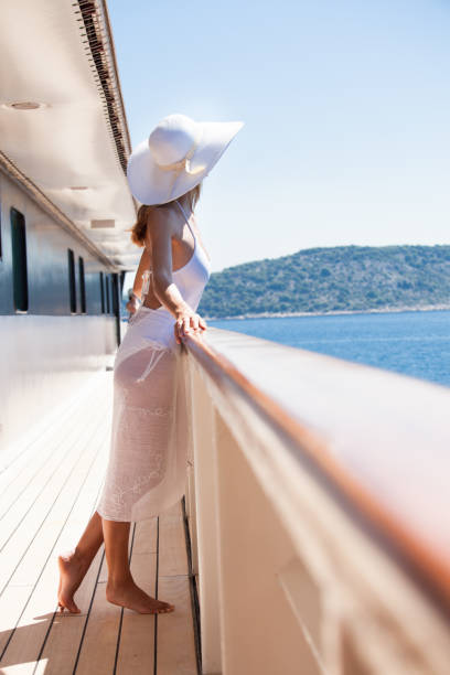 woman on a boat admiring the sea - mid adult women stock pictures, royalty-free photos & images