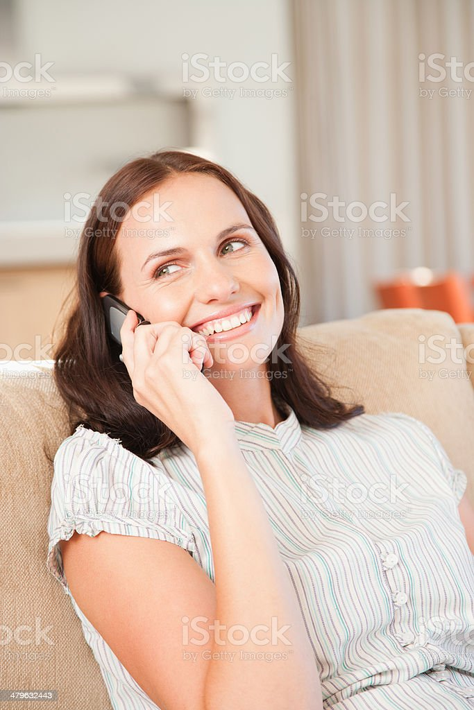 Woman on a cellular phone laughing