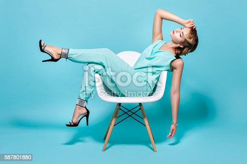 istock Woman on a chair in pin-up style. 587801880