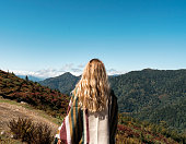 istock Woman on a hill and admires the beautiful view 1158224358