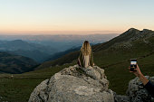 istock Woman on a hill and admires the beautiful view 1158225165