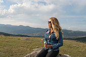 istock Woman on a hill and admires the beautiful view 1158225301