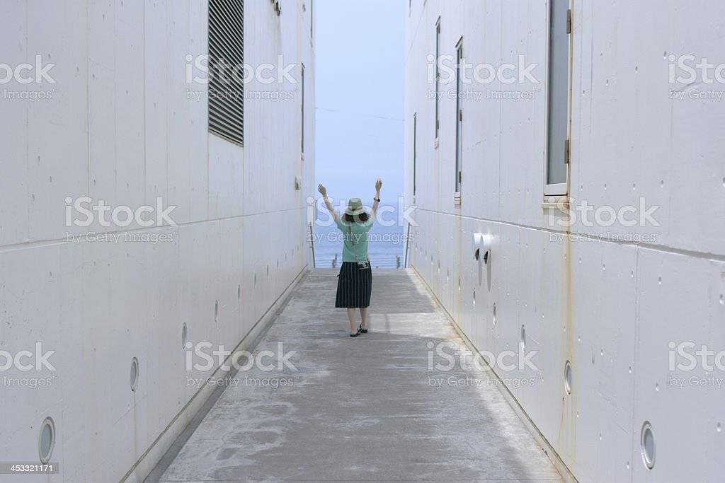 Woman on a path toward the seaside. royalty-free stock photo