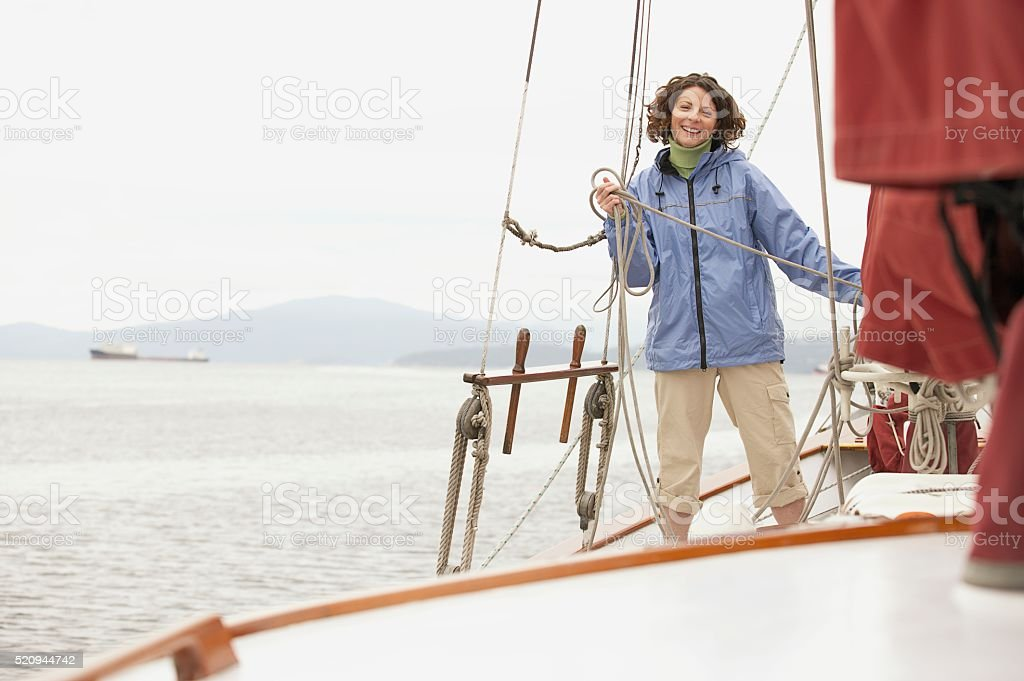 Woman on a sailboat stock photo