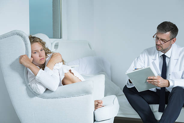 Woman on a session with a psychiatrist stock photo