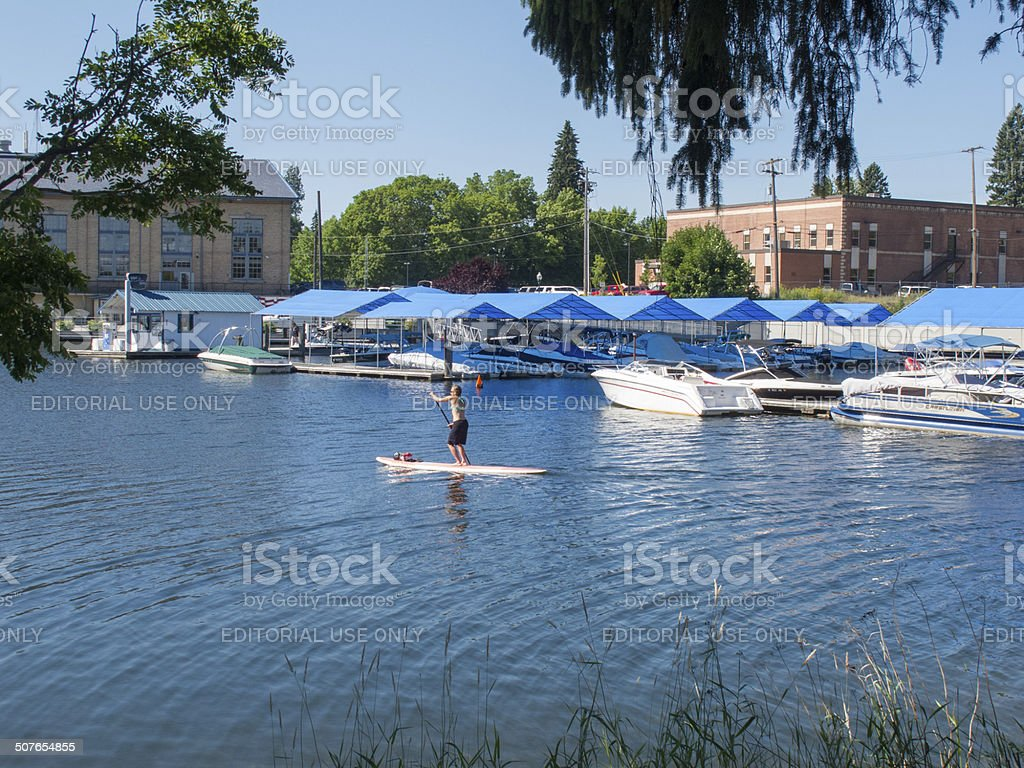 Woman on a stand up paddleboard in Sandpoint Idaho stock photo