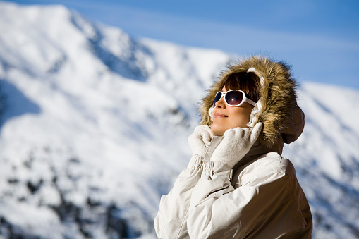 woman on a terrace in snowy mountains