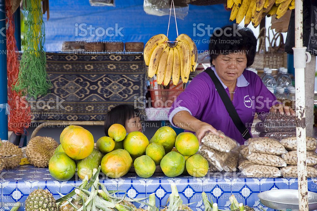 Woman on a traditional market royalty-free stock photo