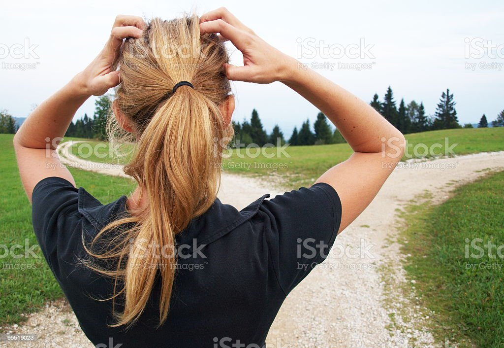Woman on a trail feeling frustrated stock photo
