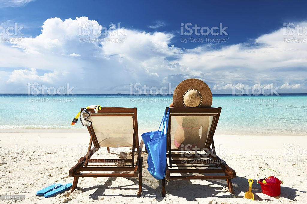 Woman on a tropical beach in chaise lounge royalty-free stock photo