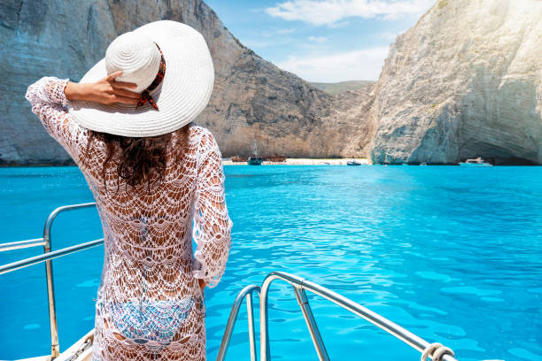 Woman on a yacht on the island of Zakynthos, Greece stock photo
