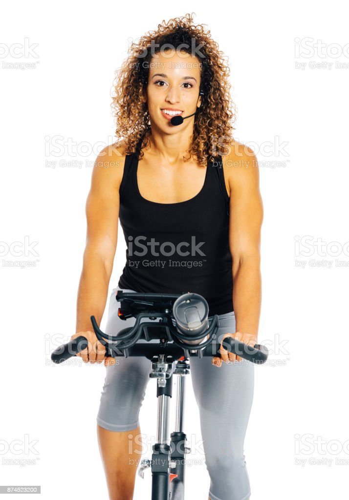Woman on an Exercise Bike stock photo
