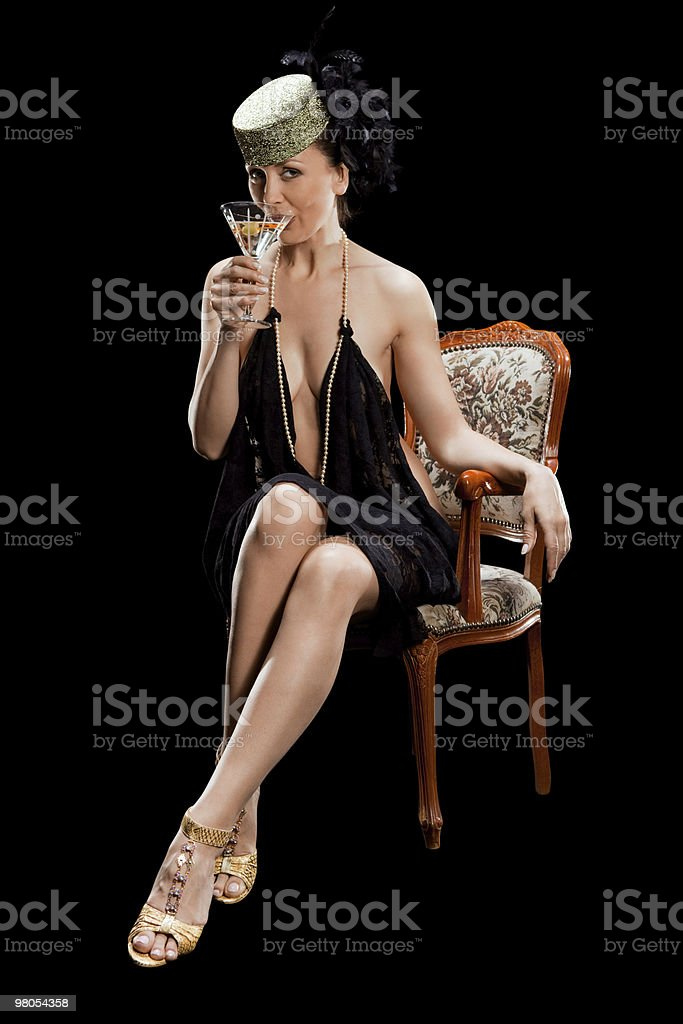 woman on arm chair,  with glass of cocktail royalty-free stock photo