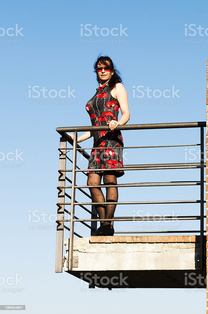 Woman on balcony royalty-free stock photo