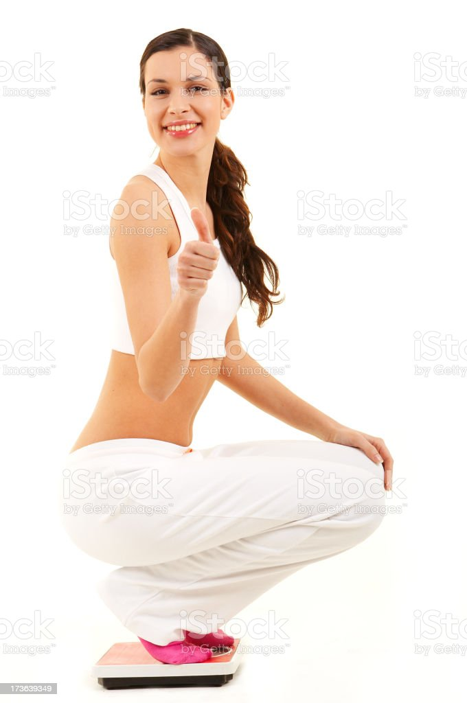 Woman on Bathroom Weight Scale royalty-free stock photo