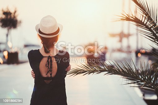 Rear view of tourist woman at the marina