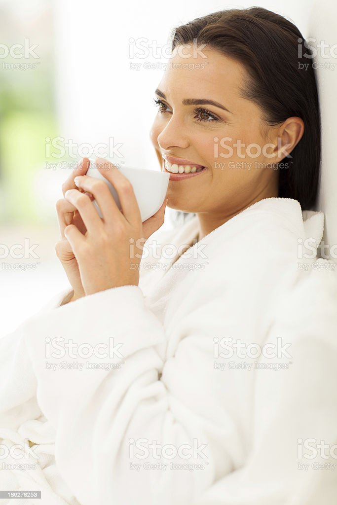 woman on bed drinking morning coffee royalty-free stock photo