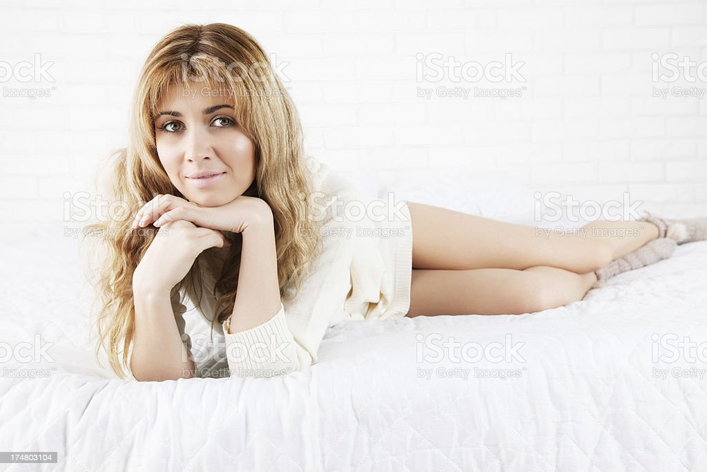 Woman on bed royalty-free stock photo