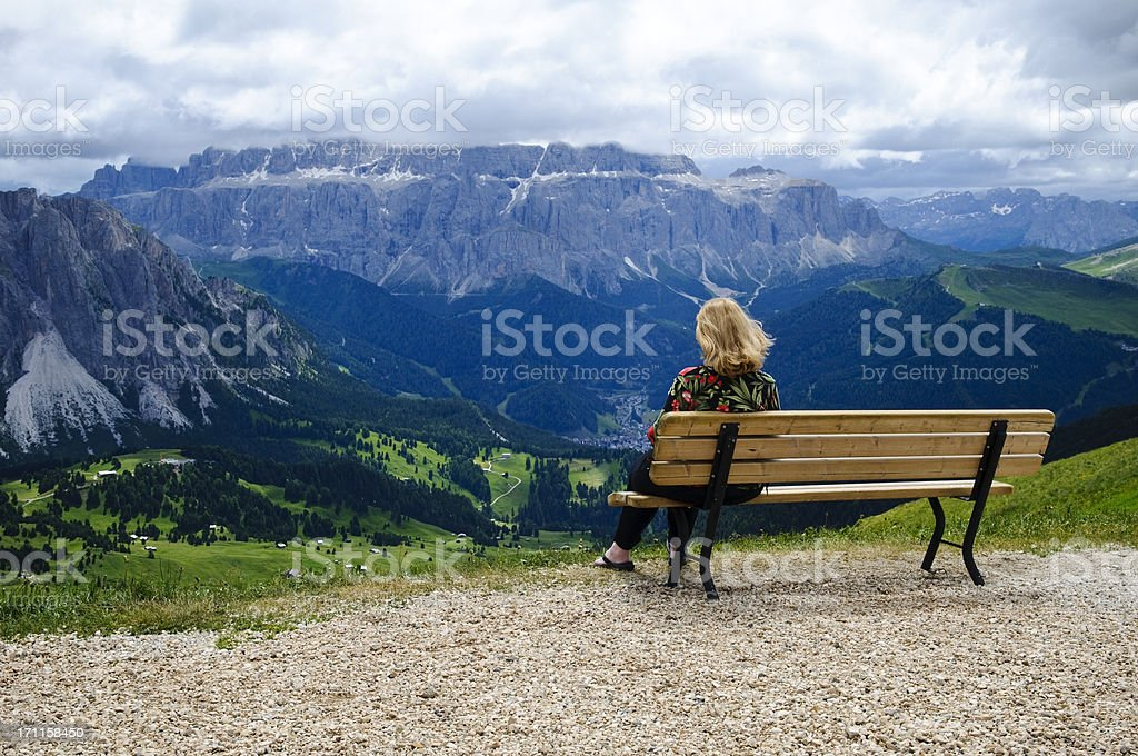 Woman on bench at Mt. Seceda, Val Gardena, Italy royalty-free stock photo
