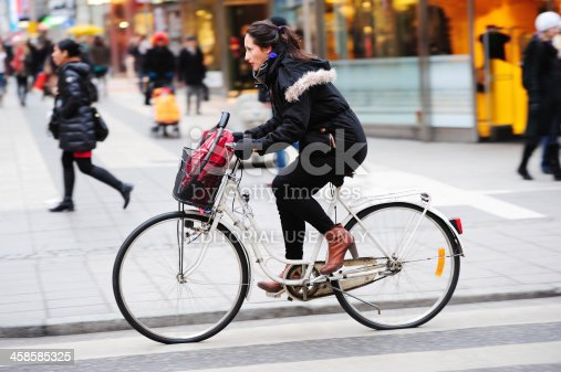 863454090 istock photo Woman on bicycle in profile 458585325