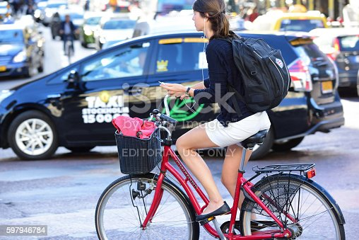 863454090 istock photo Woman on bicycle in profile 597946784