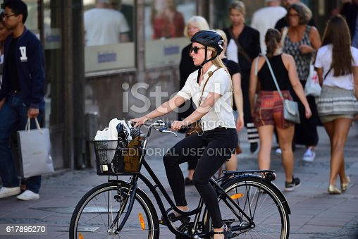 863454090 istock photo Woman on bicycle in profile 617895270