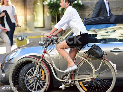 863454090 istock photo Woman on bicycle in profile, with phone 621361224