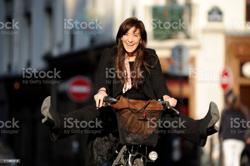 Woman on Bicycle with Legs Spread Paris France royalty-free stock photo