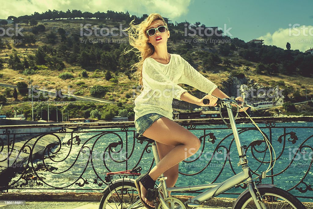 Woman on bike royalty-free stock photo